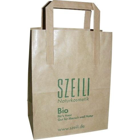Effen papieren zak of tas met platte handvaten